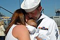 US Navy 070523-N-7653W-183 Boatswain's Mate Seaman Brad Croft, assigned to guided-missile destroyer USS Mason (DDG 87), hugs his wife and son following the ship's return to Naval Station Norfolk after the longest deployme.jpg