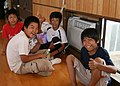 US Navy 070720-N-4270H-014 Four Japanese boys show their appreciation for the newly installed air conditioning units at the Arahama Community Center.jpg