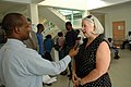 US Navy 070903-N-6020F-157 U.S. Ambassador to Haiti Janet Sanderson is interviewed by local U.S. Embassy media staff member Joel Lorquet at Centre Hospitalier Eliazar Germain in Pétion-Ville.jpg