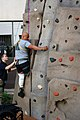 US Navy 071015-N-5086M-037 U.S. Spc. Saul Martinez, who has sustained injury during combat, climbs the new 30-foot rock-climbing wall in the Comprehensive Combat and Complex Casualty Care (C5) facility at Naval Medical Center S.jpg