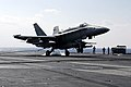 US Navy 071112-N-7883G-002 An F-A-18C Hornet, assigned to Strike Fighter Squadron (VFA) 192, lands on the aircraft carrier USS Kitty Hawk (CV 63).jpg