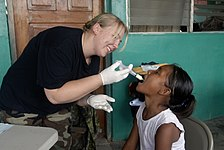 US Navy 080813-N-3595W-200 A U.S. Air Force medic gives medicine to a Nicaraguan girl during a Continuing Promise 2008 humanitarian assistance project.jpg