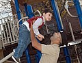 US Navy 081115-N-9268E-008 Yeoman 1st Class Luis Lujan takes time to play with his son at a local park.jpg