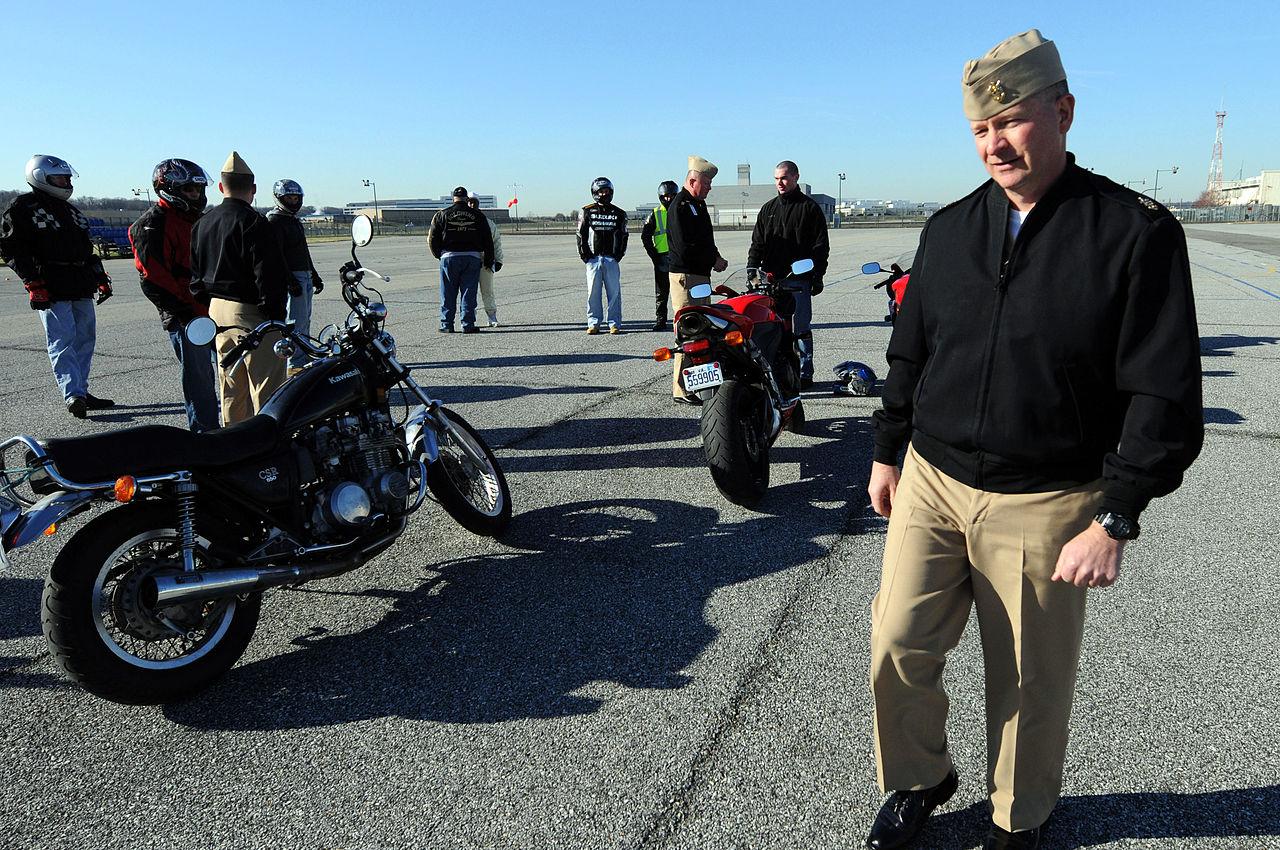 navy motorcycle rider