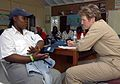 US Navy 090510-N-6259S-065 Navy physician Capt. Annette Beadle checks a patient's medical record during a Continuing Promise 2009 community service project at All Saint's School.jpg