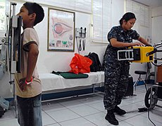 US Navy 090704-N-6259S-007 Hospital Corpsman 2nd Class Kleinne Lapid takes a chest X-ray of a patient during a Continuing Promise 2009 medical community service project at Hospital Espana in Chaminga, Nicaragua.jpg
