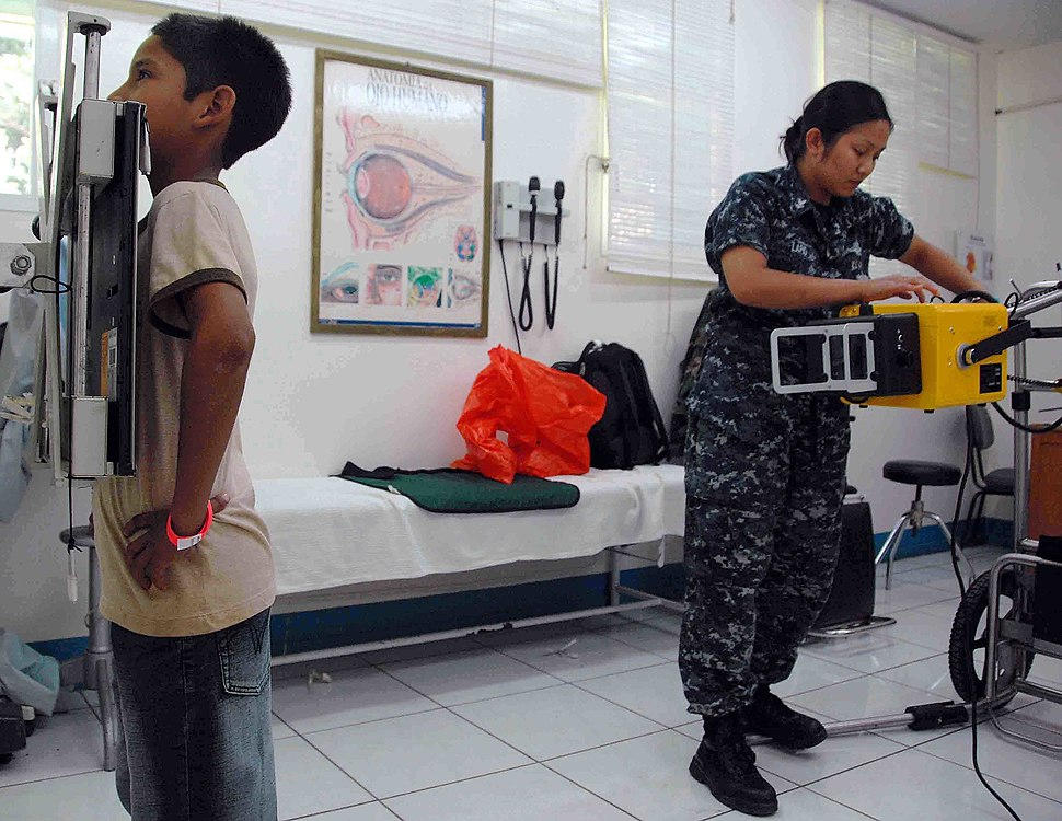 US Navy 090704-N-6259S-007 Hospital Corpsman 2nd Class Kleinne Lapid takes a chest X-ray of a patient during a Continuing Promise 2009 medical community service project at Hospital Espana in Chaminga, Nicaragua