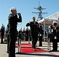 US Navy 091218-N-1011K-195 Rear Adm. Robert P. Girrier, vice commander of Naval Mine and Anti-Submarine Command, renders a salute to the side boys at the change of command ceremony for Destroyer Squadron (DESRON) 21.jpg