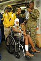 US Navy 100121-N-5345W-005 An injured Haitian woman waits for a medical transport to USNS Comfort (T-AH 20).jpg