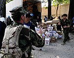 US Navy 100124-N-7948C-082 British Royal navy Cmdr. David Salisbury, embarked aboard USS Gunston Hall (LSD 44), helps deliver donated goods from Mexico to more than a thousand people in a school yard in Killick.jpg