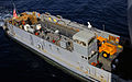 US Navy 100201-N-5214S-002 anding Craft Unit (LCU) 1663, assigned to Assault Craft Unit (ACU) 2, performs a stern gate marriage with the amphibious assault ship USS Bataan (LHD 5) to take on humanitarian relief supplies.jpg
