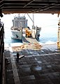 US Navy 100209-N-4971L-097 Army Landing Craft Utility (LCU) 2000 conducts a stern-gate marriage with the amphibious dock landing ship USS Fort McHenry (LSD 43) to take on pallets of relief supplies.jpg