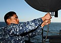 US Navy 100324-N-6509M-016 Aerographer's Mate Airman Apprentice Dante J. Blesoch prepares to release a weather balloon o analyze atmospheric pressure and temperature.jpg