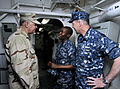 US Navy 100326-N-8273J-262 Chief of Naval Operations (CNO) Adm. Gary Roughead, left, and Cmdr. Ed Devinney, commanding officer of the guided-missile destroyer USS Cole (DDG 67), thank Sailors for their hard work while deployed.jpg