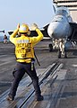 US Navy 100806-N-0593C-040 An Aviation Boatswain's Mate (Handling) directs an F-A-18F Super Hornet.jpg
