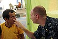 US Navy 100825-N-1531D-042 Lt. Brian Engesser, from Camp Lejuene, N.C., examines a Costa Rican man's eye during a Continuing Promise 2010 medical civic action event.jpg