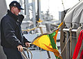 US Navy 110428-N-XO436-059 Quartermaster Seaman Clayton Judd hoists the preparation flag aboard the guided-missile destroyer USS Barry (DDG 52) dur.jpg