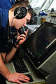 US Navy 110519-N-RG360-030 Operations Specialist Seaman Ruben Ward, from Douglas, Ga., tracks contacts on radar systems on the bridge aboard the ai.jpg