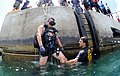 US Navy 110614-N-XD935-042 Navy Diver 2nd Class Ryan Arnold guides Chief Hospital Corpsman Nathanael Warren, who is acting as an unconscious diver.jpg