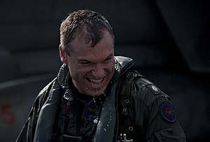 US Navy 111222-N-DR144-420 Cmdr. John Boone, commanding officer of Strike Fighter Squadron (VFA) 81, laughs as he is hosed down by his squadron mat.jpg
