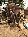 Ushafa Potters of Nigeria pounding clay.jpg
