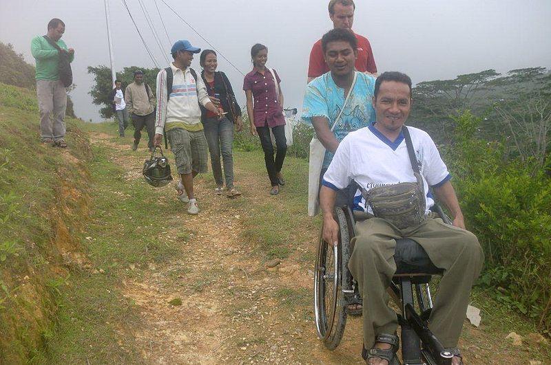 File:Using wheelchairs on dirt roads (10686992666).jpg
