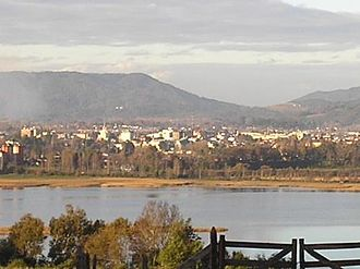 Cruces River - View of Valdivia from the western side of Cruces River