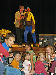 A ventriloquist entertains children at the Pueblo, Colorado Buell Children's Museum.