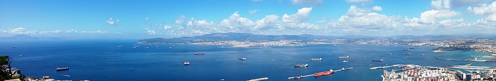 Morocco (top far left across Strait); Spain: Algeciras (top centre across Bay of Gibraltar) and La Linea (right); Gibraltar cruise port and airport runway (right foreground); from the Rock