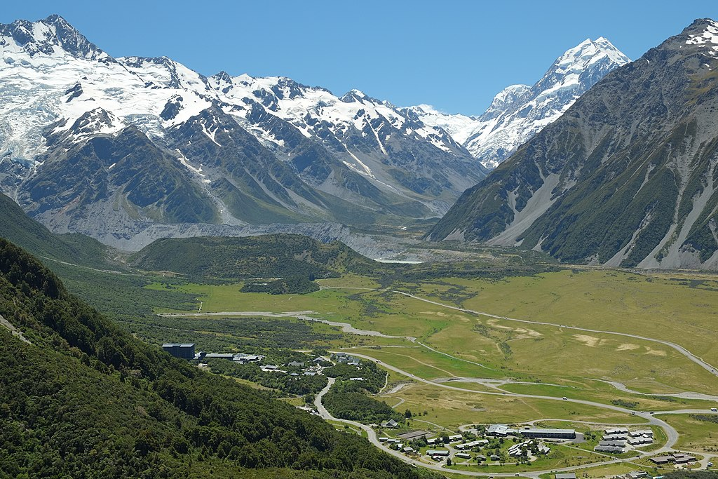 Mount Cook Village down below in Hooker Valley, The Hermitage on the left, lodge & motel complex on the bottom right