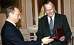 Vladimir Putin met with former U.S. President George Bush Sr.jpg