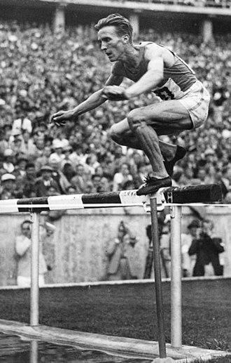 Volmari Iso-Hollo - Iso-Hollo running the steeplechase at the 1936 Summer Olympics.