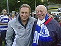 Warnock with a fan during Pre-Season 2011.jpg