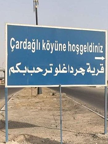 Bilingual sign, Turkish (top) and Arabic (bottom), at a Turkmen village in Kirkuk Governorate, Iraq. Welcome sign to the village of Cardagli.jpg
