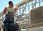Well drillers clean equipment 150808-F-LP903-0258.jpg