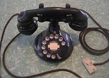 "A Western Electric model 102 telephone with B1 base and E1 handset with early ""spitcup"" mouthpiece, refitted with new cords and modular plug."