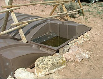 """Pryor Mountain mustang - A """"guzzler"""" (precipitation trap and storage tanks designed to provide water to wildlife) on the Pryor Mountains Wild Horse Refuge."""