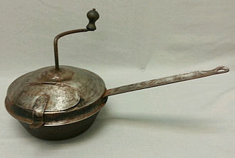 Coffee roasting - A hand-cranked wood stove top coffee roaster circa 1890–1910