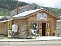 """The Dog House"" in the main Street of Dawson City, Yukon (3900546326).jpg"