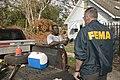 (Hurricane Katrina) New Orleans, LA, 11-16-2005-- FEMA Deputy Federal Coordinating Officer, Ted Monette listens as an Upper 9th Ward hurricane Katrina resident talks about his prope - DPLA - 79d62fd0e98a860609086cd3d8782cf8.jpg
