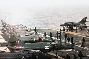 French aircraft carrier Foch (R99) - Six Aéronavale Dassault Super Étendard ant two Étendard IVM (foreground) fighters aboard the French aircraft carrier Foch (R99) off the coast of Lebanon, in 1983.