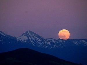 Vihren - Full moon on 2 June 2015 from Vlahina Mountain looking at Pirin National Park. Left of the moon is Vihren Peak