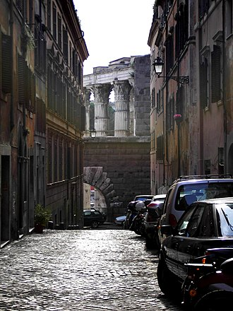 Forum of Augustus - The fireproof wall with Arco dei Pantani and the columns of the temple.