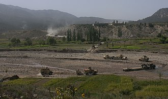 Paktika Province - A convoy with members of Task Force 2-28, 172nd Infantry Brigade and the Afghan National Army winds its way through a small valley on its way back to Forward Operating Base Orgun-E from Combat Outpost Zerok