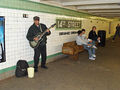 Musician playing on the southbound IND platform