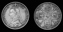 Two sides of a coin, with head view of Victoria on one side and a design on the other