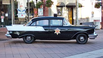 Black and white (police vehicle) - A 1957 Chevrolet police car. Unusually, rather than contrasting panels this uses a factory two-tone also available to the public.