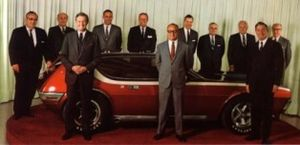 AMC AMX-GT - AMC directors with the AMX GT. Front, left to right: Roy D. Chapin Jr., William V. Luneburg, and Richard E. Cross