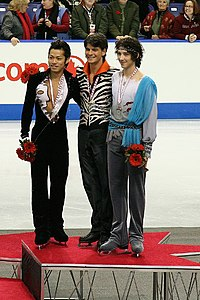 Left to right Daisuke Takahashi, Stéphane Lambiel, and Johnny Weir at 2006 Skate Canada. Weir placed 3rd.