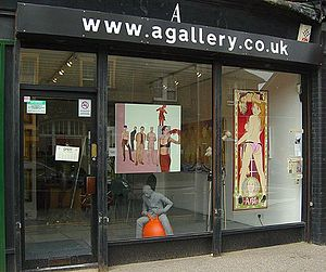 Peter McArdle - Peter McArdle's work (centre painting) in the A Gallery window, July 2007.